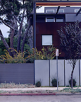 The architect has used a variety of materials in the construction of this modern house on a narrow corner plot