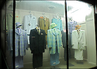 Suits on display in the window of On Time Fashions in down town Selma.