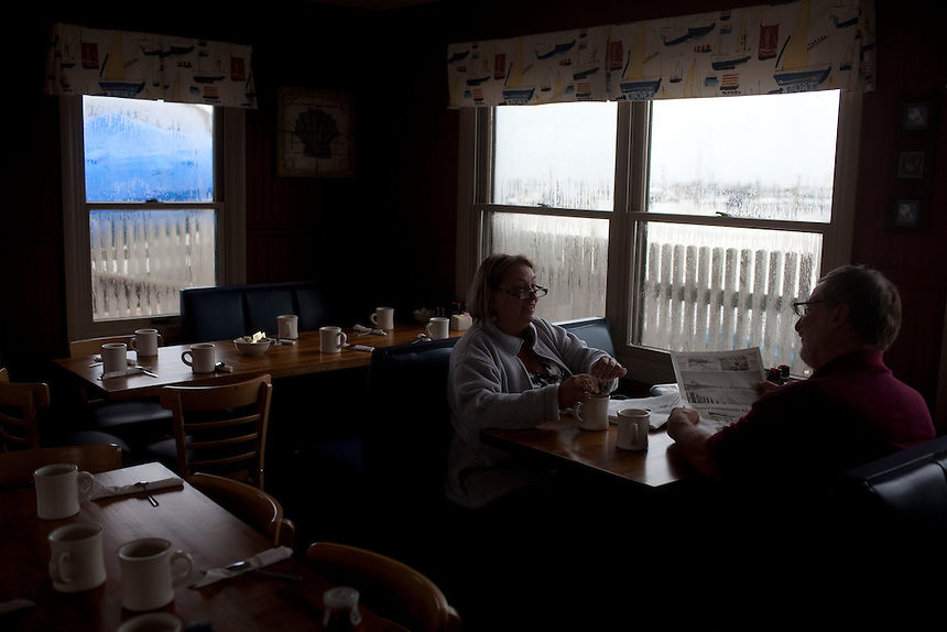 Long Beach Island, NJ - June 30, 2013 :  Nancy Stropnicky and Paul Stropnicky from Randolph, NJ, enjoy an early breakfast at the Dockside Diner on Long Beach Island, NJ on June 30, 2013. They have been coming to LBI for more than 55 years, with five generations spending their summers in a summer house on the island. People are returning to the beaches for the summer after recovery efforts post Superstorm Sandy.