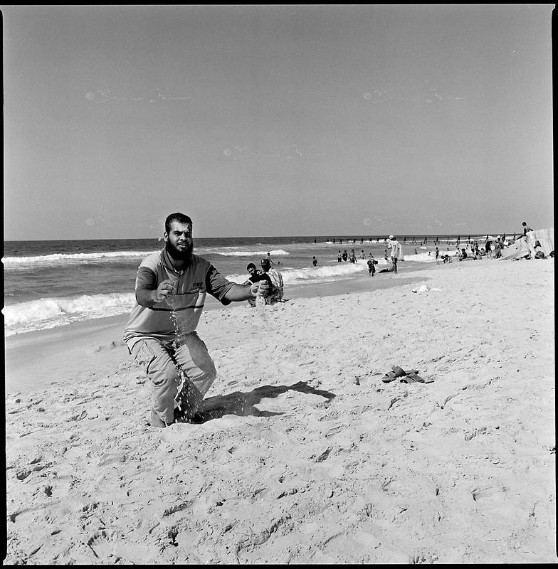 Moassi Rafah, Sept 12 2005..Afternoon prayer on the beach.