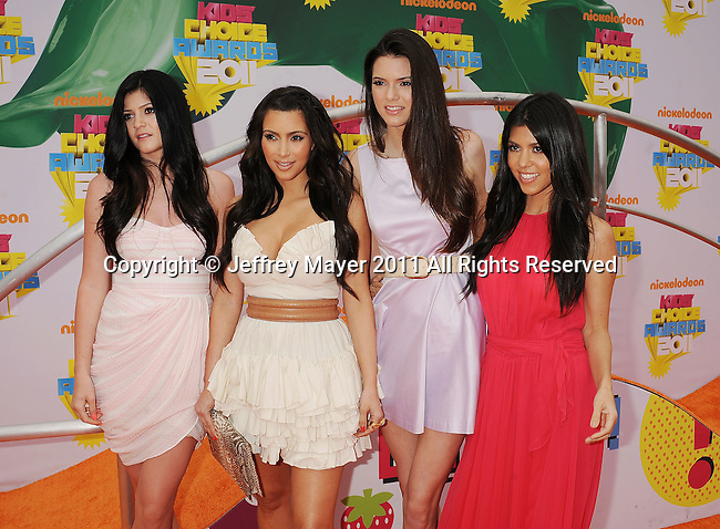 LOS ANGELES, CA - APRIL 02: Kylie Jenner, Kim Kardashian, Kendall Jenner and Kourtney Kardashian arrive at Nickelodeon's 24th Annual Kids' Choice Awards at Galen Center on April 2, 2011 in Los Angeles, California.