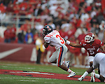 Ole Miss running back Jeff Scott (3) runs past Arkansas safety Tramain Thomas (5) at Reynolds Razorback Stadium in Fayetteville, Ark. on Saturday, October 23, 2010.