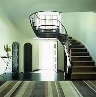 This classical entrance hall is graced by a sweeping staircase and is filled with light