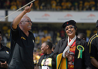 Jacob Zuma and Winnie Mandela dance on stage at an African National Congress (ANC) election rally held at the Ellis Park Stadium in Johannesburg..