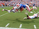 Joe Imel/Daily News.Western Kentucky's Andre Lewis hits Florida quarterback Tim Tebow in mid-air Saturday, Sept. 1, 2007, in the Hilltoppers loss in Gainesville.