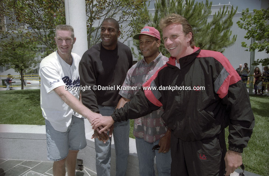 From left, NBA players and Olympic Dream Team members Chris Mullin and Magic Johnson with former San Francisco 49ers running back Roger Craig and quarterback Joe Montana at a charity event in San Francisco in the mid 1990s.