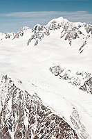 Aerial views of Fox Glacier with Mt. Tasman 3497m dominating skyline, Westland National Park, West Coast, New Zealand