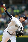 Seattle Mariners'  starting pitcher Felix Hernandez pitches to Los Angeles Angels Mike Trout  in the first inning of  season home opener April 6, 2015 at Safeco Field in Seattle.  The Mariners beat the Angels 4-1.  ©2015. Jim Bryant Photo. ALL RIGHTS RESERVED.