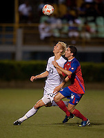 Brek Shea (23) goes for the header against Bryan Oviedo (14). Costa Rica defeated the US Under 20 Men's National team 3-0 during the 2009 CONCACAF U-20 Championship game at Marvin Lee Stadium Trinidad & Tobago in Macoya, Trinidad on March 17th, 2009.
