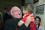 Bishop William Murphy of Rockville Centre greets a child during a visit to a camp for internally displaced families in Ankawa, near Erbil, Iraq, on April 9, 2016. Murphy and Cardinal Timothy Dolan, both board members of the Catholic Near East Welfare Association, are in Iraqi Kurdistan to visit with Christians and others displaced by ISIS.