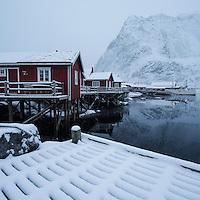 Traditional red Rorbu cabins in winter, Reine, Moskenesøy, Lofoten Islands, Norway