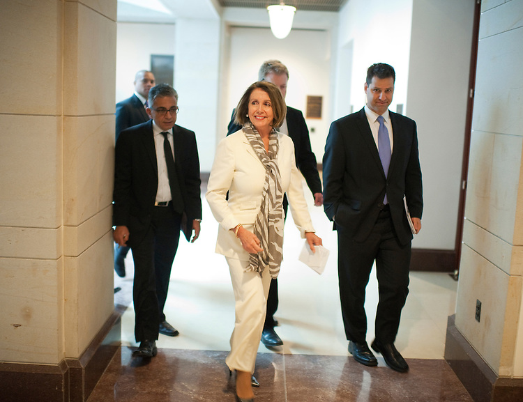 UNITED STATES - OCTOBER 04:  House Minority Leader Nancy Pelosi, D-Calif., arrives in the Capitol Visitor Center for a meeting of the House democratic caucus.  (Photo By Tom Williams/Roll Call)