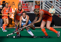 Elizabeth Drazdowski (18) of UNC tries to get past the defense of Elly Buckley (18) of Virginia during the NCAA Field Hockey Championship semfinals in College Park, MD.  North Carolina defeated Virginia, 4-3, in overtime.