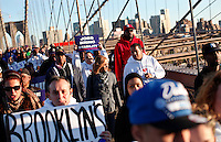 """NewYork, United States, October 25, 2011.Protesters affiliated with the Occupy Wall Street movement, march onto New York's Brooklyn Bridge in a """"day of solidarity"""" in New York October 25, 2011. VIEWpress /Kena Betancur..Forty-three percent of Americans agree with the views of the """"Occupy Wall Street"""" movement.Local media report.."""