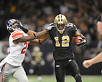 New Orleans Saints Marques Colston (12) vs. New York Giants Kenny Phillips (21) at the Superdome in New Orleans, La. on Monday, November 28, 2011. New Orleans won 49-24.