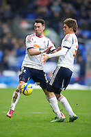 BOLTON, ENGLAND - Saturday, January 26, 2013: Bolton Wanderers' Chris Eagles and Marcos Alonso clash into each other during the FA Cup 4th Round match against Everton at the Reebok Stadium. (Pic by David Rawcliffe/Propaganda)