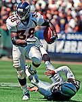 Oakland Raiders vs. Denver Broncos at Oakland Alameda County Coliseum Sunday, September 17, 2000.  Broncos beat Raiders  33-24.  Denver Broncos running back Mike Anderson (38) runs by Oakland Raiders defensive back Eric Allen (21).