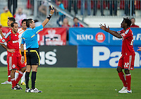 01 July 2010:  Toronto FC midfielder Amadou Sanyang #22 receives his first yellow card from the referee during a game between the Houston Dynamo and the Toronto FC at BMO Field in Toronto..Final score was 1-1....
