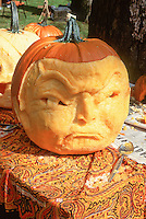 Carved pumpkin head face made into a person