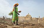 A woman plants sorghum in a small field beside her hut in the Habile Camp for internally displaced Chadians outside the village of Koukou Angarana. Some 25,000 people live in precarious conditions in this camp. More than 180,000 residents of eastern Chad have been displaced by violence spilling over from neighboring Darfur, inter-ethnic conflict, and fighting between rebels and the Chadian government.