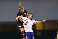 14 MAY 2011: USA Women's National Team defender Rachel Buehler (19) heads the ball over Japan National team Yuki Nagasato during the International Friendly soccer match between Japan WNT vs USA WNT at Crew Stadium in Columbus, Ohio.