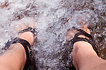A hiker's feet cooling off in a mountain stream, Tahoe National Forest California