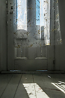 Interior view of a farm house front door.
