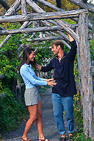 couple standing in a wooden archway