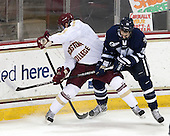 Colin Sullivan (BC - 2), Jeff Silengo (UNH - 18) - The Boston College Eagles and University of New Hampshire Wildcats tied 4-4 on Sunday, February 17, 2013, at Kelley Rink in Conte Forum in Chestnut Hill, Massachusetts.