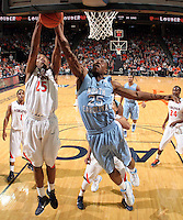 Jan. 8, 2011; Charlottesville, VA, USA;  Virginia Cavaliers forward Akil Mitchell (25) fights for the rebound with North Carolina Tar Heels forward Justin Knox (25) during the game at the John Paul Jones Arena. North Carolina won 62-56. Mandatory Credit: Andrew Shurtleff