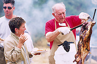 Carving and Serving Cooked  Lamb Meat at the Annual Lamb Barbecue on Saturna Island, in the Southern Gulf Islands of British Columbia, Canada