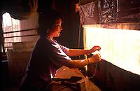Weaving Tibetan carpets at carpet factory.