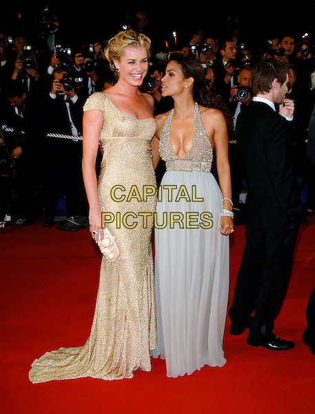 "REBECCA ROMIJN & HALLE BERRY. ""X-Men 3: The Last Stand"" screening.59th International Cannes Film Festival, France.22nd May 2006.Ref: PL.full length x men gold beaded dress grey silver beaded crystals cleavage low cut plunging neckline halterneck.www.capitalpictures.com.sales@capitalpictures.com.©Phil Loftus/Capital Pictures"
