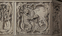 Detail of bas-relief sculpture, mid 13th century, on the base of the portal of the Upper chapel of La Sainte-Chapelle, Paris, France. One of a series of reliefs illustrating scenes from the Old Testament book of Genesis. Here we see Abraham preparing to sacrifice Isaac. Behind them a ram is caught in a thicket. Each panel has a decorated curly frame with mythical beasts in the corner. Sainte Chapelle was built 1239-48 to house King Louis IX's collection of Holy Relics. It is a UNESCO World Heritage Site. Picture by Manuel Cohen.