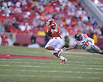 Arkansas running back Knile Davis (7) gets past Ole Miss safety Johnny Brown (20) for a touchdown at Reynolds Razorback Stadium in Fayetteville, Ark. on Saturday, October 23, 2010.