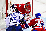 10 April 2010: Montreal Canadiens' goaltender Jaroslav Halak makes a save on left wing forward Viktor Stalberg during the last game of the regular season against the Toronto Maple Leafs at the Bell Centre in Montreal, Quebec, Canada. The Leafs defeated the Habs 4-3 in sudden death overtime as the Canadiens advance to the Stanley Cup Playoffs with the single point. Mandatory Credit: Ed Wolfstein Photo