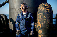 Forth engineer Jens Jensen next to one of the funnels on the Mary Maersk, the largest container ship in the world.