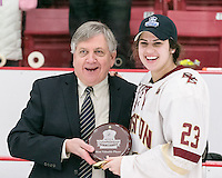 Boston, Massachusetts - March 5, 2017: NCAA Division I. Women's Hockey East (WHEA) championship. In overtime, Boston College (white) defeated Northeastern University (red), 2-1, at Walter Brown Arena.