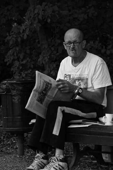 A former East German political prisoner holds a daily vigil in memory of people who died trying to escape to the West near the Reichstag building in Berlin, Germany. Aug. 1, 2007.