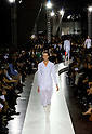October 25th, 2011: Tokyo, Japan – A model walks down the catwalk wearing JIL SANDER during Japan Premiere of I AM LOVE / Jil Sander Fashion Show Spring/Summer 2012 in the National Art Center Tokyo. (Photo by Yumeto Yamazaki/AFLO)