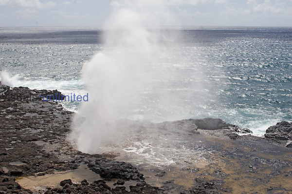 Spouting Horn blowhole shoots ocean water  high in the air.Kauai, Hawaii