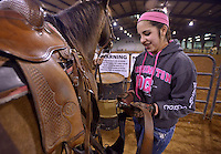 NWA Democrat-Gazette/BEN GOFF -- 02/01/15 Hallie Toan, 15, of Siloam Springs unsaddles her horse following practice of the Rodeo of the Ozarks Rounders in Isuba Valley Horse Park near Siloam Springs on Sunday, Feb. 1, 2015.
