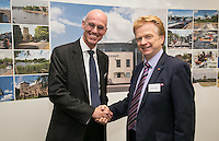 Branch manager Ian Davys greets Councillor Neil Clarke, leader of Rushcliffe Council, who own The Point, where Handelsbanken's West Bridgford branch has opened.