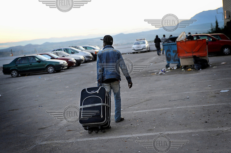 An illegal migrant, with his belongings in a suitacase, heads to an aid centre. He, like thousands of other migrants, has come to the region to pick olives but this year there is competition for the work. The economic collapse means that work once shunned by the indigenous population is now sought after by unemployed Spaniards.