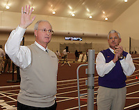 Coach Pat Henry(left) Texas A&M head coach and Coach Dennis Shaver(right) LSU head coach acknowledges the fans prior to Texas A&M vs. LSU Dual competetion at Gilliam Indoor-McFerrin Athletic Center on the campus of Texas A&M, College Station,Texas on Saturday, January 22, 2011. Texas A& M won the men competetion Texas A&M 84-LSU 75, women score Texas A&M 91-LSU 67.Photo by Errol Anderson