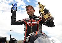 Jul, 22, 2012; Morrison, CO, USA: NHRA pro stock motorcycle rider Eddie Krawiec celebrates after winning the Mile High Nationals at Bandimere Speedway. Mandatory Credit: Mark J. Rebilas-US PRESSWIRE
