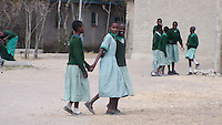 In a small town on the outskirts of Kajiado, Kenya, one school offers hope to many girl students who otherwise might have been forced to undergo FGM (Female Genital Mutilation) and Forced Early Marriage. In Kenya, it is now an illegal practice to marry a child bride however most homesteads are situated in extraordinarily rural locations which make it difficult to monitor such activity.   Most girls drop out of school by the age of 10.  The students at this school demonstrate their appreciation of the gifts of education and friendship.