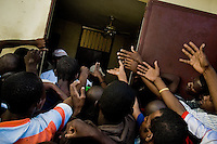 People fight over food in Saint Claire, the food distribution center run by Fr. Gérard Jean-Juste in Port-au-Prince, Haiti, July 8, 2008.