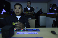 Bolivian Navy students in navigation class learn with a boat simulator at the Naval School in La Paz. Bolivia lost what is now northern Chile in a war over nitrates leaving Bolivia without access to the ocean.