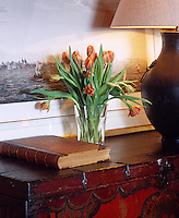 Detail of a vase of tulips on a chest in the landing